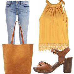 Jeans stretto e top giallo ricamato a fiori, sandalo con cinturino in cuoio che richiama i colori etnici, borsa a tracolla cognac, per semplici passeggiate o a all'università!