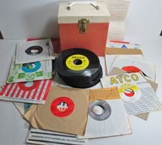 45 RPM Vintage Records with Storage Case