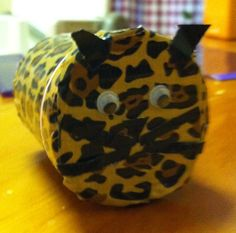 Leopard cache made from duck tape and a medium recycled pill bottle.  It will be hidden in tall grass outside of a zoo! #geocaching