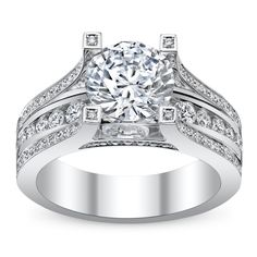 http://m.robbinsbrothers.com/Engagement-Rings/Ring-With-Sidestones/Michael-M--i35891.ring