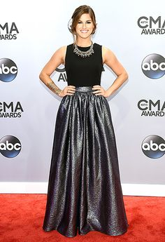 Cassadee Pope~Pope, who rose to fame competing on The Voice, shined in a sweeping metallic skirt, sleeveless black top, and a statement necklace.