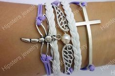 Silver wings pearl white leather bracelet by Hipstersjewelry, $9.99