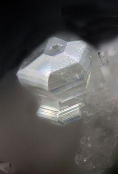 Iodargyrite, AgI, Beauvoir quarry, Échassières, Ébreuil, Allier, Auvergne-Rhône-Alpes, France. Fov 0.30 mm. Iodargyrite crystal on quartz. Copyright: © y.vessely