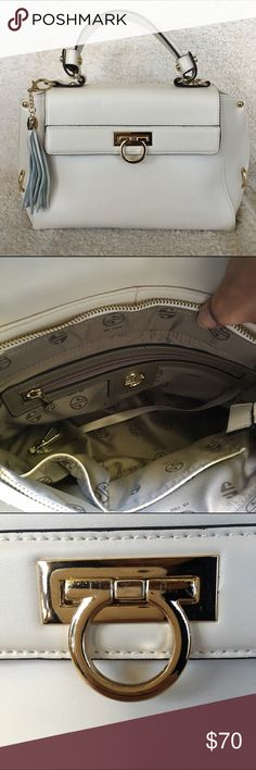 """Segolene En Cuir cream leather handbag Segolene En Cuir cream leather Charlotte satchel in excellent condition, never used. There are a few scratches on the hardware from display handling (picture 3). No dustbag and does not come with a long strap. Interior is pristine. No scratches or wear on the gold hardware feet. Approx size: 14""""L x 8""""H x 5.5""""D. Strap drop 5"""". Segolene En Cuir Bags Satchels"""