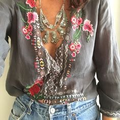 Embroidered shirt with indian coin necklace