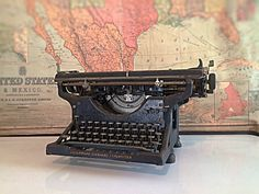 Very elegant and stately Black Underwood Typewriter from the early 1900s - 1920s. Model number: 597043-14. The back left leg stand is missing, but