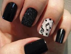 Black nails with music notes on the accent finger. I think this is perfect for piano and other music concerts.