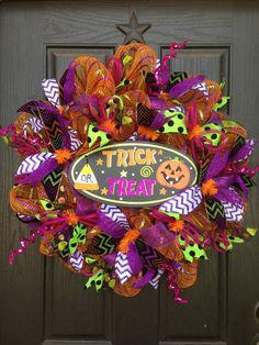 Trick or Treat!!!  Can be purchased from our Facebook page! Www.facebook.com/GlitzyWreaths