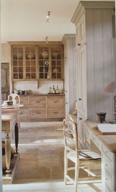 I really like the colors in this kitchen and all the different materials...