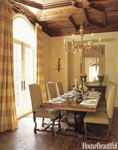 A dining room with a grand ceiling based on an Addison Mizner design. Design: Fern Santini