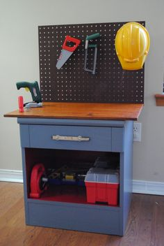 Oldnight stand turned dramatic play workbench.  So much cheaper then buying an actual pretend play workbench.  Love this!