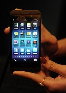 The BlackBerry Z10 smartphone is displayed dur...