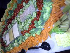 Vegetable table display with ranch x italian dressing x crackers x shaved turkey breast and carved smoked honey ham