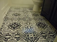 Cowgurl's Blessing: Small Bathroom Makeover - stenciled bathroom floor