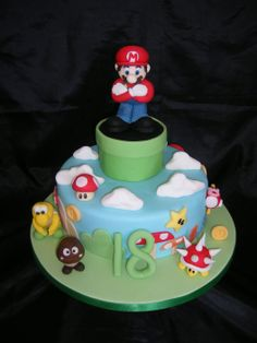 Super Mario Cake - This is a totally edible Super Mario Cake, all models are hand made out of a 50/50 gumpaste fondant mix, and the green tube is RKT. The cake is a 9 inch round chocolate. Made for my brother in law who turned 18 on sunday, he is autistic and loves retro computer games, he loved it.