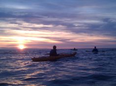 The bride, groom, and wedding party enjoying a sunrise kayak the morning of the Big Day - on the waters surrounding Mackinac Island, MI - near Arch Rock