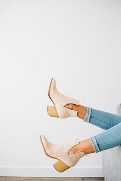 A daring take on the season's Western trend, this city-slick cowgirl boot features sultry side slits and is highlighted with a trendy block heel.
