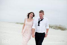 bride and groom beach stroll (photo by eric boneske)