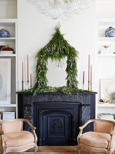 Love this pagoda-inspired DIY garland mantel display that beautifully frames this mirror in greenery, and perfectly decorates the fireplace mantel -- 3 Fresh Takes on DIY Holiday Greenery from our resident Weekend Decorator Megan Pflug! Get the full DIY instructions over on our Style Guide here.