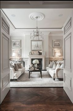 We adore this symmetrical living room! #coachbarn #livingroomdesign #design