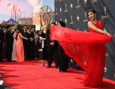 Bollywood star Priyanka Chopra wowed the crowd in a pleated one-shoulder red Jason Wu goddess gown with a full skirt