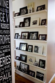 DIY photo gallery wall idea. You can change out the pictures or rearrange them without having to deal with the hassle of hanging them