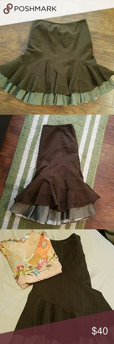 """DKNY fully lined ruffle skirt with pin stripe Gorgeous dark brown ruffle skirt has a side zip closure and pretty DKNY Jeans embroidered at top. Fully lined with an adorable olive green polka dot polyester/rayon blend. 23"""" long 30"""" waist. Excellent condition. DKNY JEANS Skirts"""