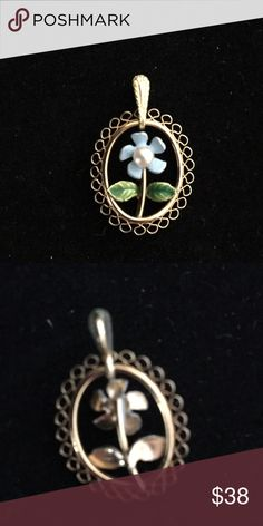 Krementz Forget Me Not pendant. Krementz Forget Me Not pendant. No chain. Very delicate baby blue flower with a pearl. Beautiful condition. Jewelry Necklaces