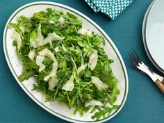 Arugula Salad with Olive Oil, Lemon, and Parmesan Cheese recipe from Tyler Florence via Food Network