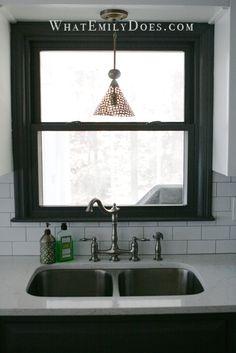 Love the dark trim around the window with the subway tile