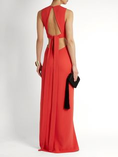 Elie Saab's stretch-cady gown comes in a stunning crimson-red shade, and turns to reveal an open back with draped self-fastening ties.