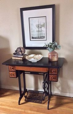 This beautiful antique Singer Sewing machine has been repurposed to use as a table, desk or vanity with a replaced antique wood flat top. Its in great shape and still has all the original drawers and...