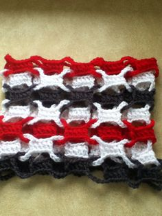 Crochet cowl only using double crochet, chains, and slip stitch. One color at a time weaved through each other.