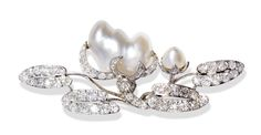 An antique jewelled water-lilly brooch, platinum, in the form of a flowering water-lilly, the openwork pads set with cushion cut diamonds the flowers composed of baroque pearls. Possibly French, c.1900.