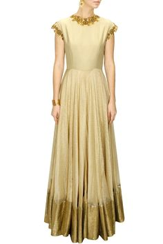 This offwhite anarkali suit is featuring in a gold tissue kota long gown with antique sequins and metal flower embellished.