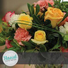 Centerpiece by Fleurish Floral Design | Green Pitt, Blupleurum, Bear Grass, Lycopodium, Creme de la Creme Roses, Peach Roses, Pink Roses, White Carnations, and Pink Carnations