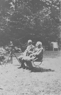 Chautauqua History. Thomas Edison and Henry Ford  photo of them seated on a bench in the garden behind the Miller Cottage at Chautauqua Institution.  Notation on back:  In the Lewis-Miller Garden.  Thomas Edison and Henry Ford Aug 1929.