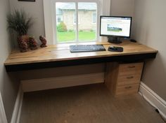 My homemade desk using 150 year old barn board and a couple 2x4s.