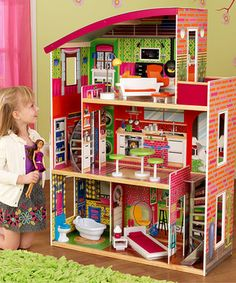 Little decorators will delight over this darling dollhouse. With three floors of open space to design, 11 detailed pieces of furniture, two curved staircases and large side windows for peering in at any angle, it accommodates bitty house parties, sleepovers and other adventures.