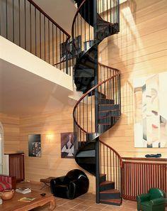 DH1 - SPIR'DÉCO® Bistrot avec contremarches. Escalier intérieur d'accès mezzanine sur 2 niveaux, hélicoïdal métal et bois pour une décoration rétro. Cet escalier en fer forgé, avec son look 'fin XIXème siècle', inspiré des bistrots français, sa rampe à l'ancienne, la chaleur de ses marches et de sa main courante en bois, s'intègre dans tout type d'intérieur avec charme et caractère. Marches en tôle lisse pliée avec plateau bois massif. Limon formant crémaillère en tôle roulée. Rampe à…