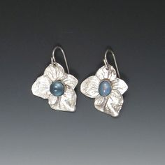 Matching hydrangea blooms cast into sterling and set with London blue topaz - earrings from Carina Rossner Organics