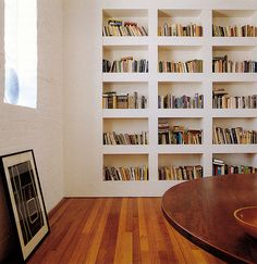 Clean-lined, recessed built-in bookcase; almost looks like a gallery wall