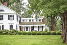 Bunny Williams' home painted in a crisp white. We're sharing how to pick the right exterior paint color for your home.