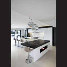 This contemporary kitchen forms part of a rear-of-house extension that has created one large entertainment space. The shift in ceiling heigh...