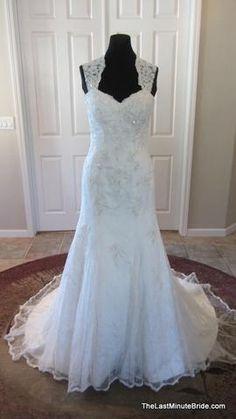 Description Essense of Australia Bridal Gown Style D1264 Designer's Description This stunning trumpet wedding dress with chapel train is unforgettably romantic with its lace trimmed shoulder straps an