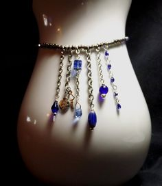 Blue & Silver Dangly necklace by WingedPennyDesigns on Etsy