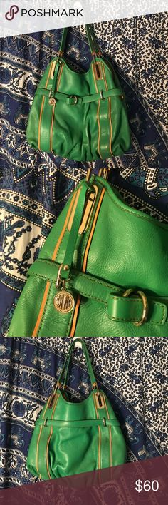 DKNY Hobo Bag Green with brown and gold accents. 3 compartments with smaller zip pockets. PERECT condition, I was given this as a gift and never used it. No dust bag. DKNY Bags Hobos