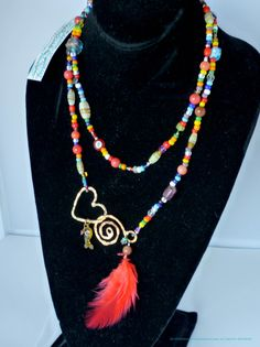 Red and multi lariat Love beads with a brass hand hammered Maria-Tina Signature clasp. Includes feather and vintage beads collected by Maria-Tina. - Can be worn as a long necklace - lariat - double ne