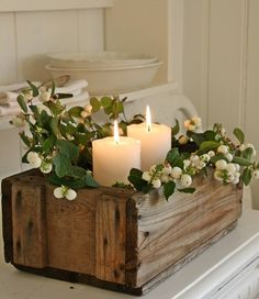 Simple wood box with candles and mistletoe  for a Table piece