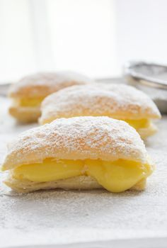 Sporcamuss Italian Cream Filled Pastries – An Italian in my Kitchen A delicious Italian Pastry Cream filled Puff Pastry Square, Sporcamuss, a traditional recipe from Southern Italy, fast easy and… Italian Pastries, Italian Desserts, Easy Desserts, Delicious Desserts, Yummy Food, Puff Pastries, Fast Dessert Recipes, Gourmet Desserts, French Pastries